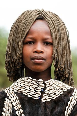 ethiopian: omo valley, ethiopian, august 10, 2011 - girl of ethnic tsemay, tsemay are the shepherds who inhabit the lower omo. Editorial