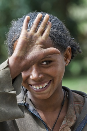 Ghasena, Ethiopia, August 2, 2011: Young ethnic kindly greets Amara, Amara is the 24% of the country's population.