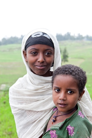 ethiopian ethnicity: Lalibela, Ethiopia, August 3, 2011: Children of ethnic Amara, Coptic Christian religion, live in the north and center of the country, with 24% of the population.