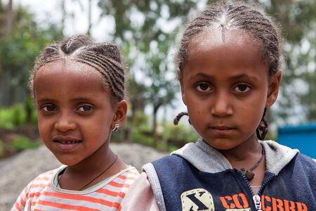 Lalibela, Ethiopia, August 3, 2011: Girls of the Amara ethnic group through the streets of Lalibela