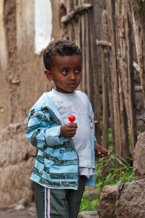 ethiopian ethnicity: Lalibela, Ethiopia, August 3, 2011: Child of the Amara ethnic group through the streets of Lalibela Editorial