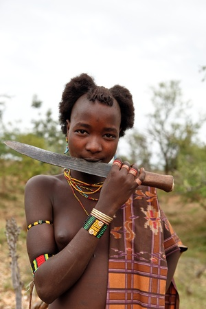 Dimeka, Ethiopia, 13 August 2011: Young Hammer of ethnic pride displayed his knife.
