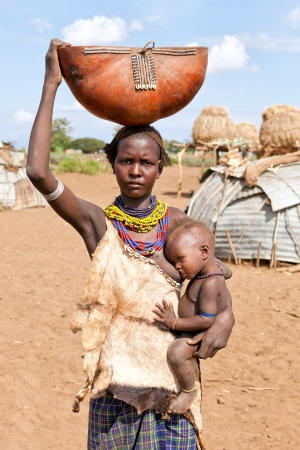 landed:  ETHIOPIA - AUG 15:  Women of ethnic Erbore with her child,the ethnic groups in the The Omo valley Could disappear Because of Gibe III hydroelectric dam. on Aug 15, 2011 in Omo Valley, Ethiopia. Editorial