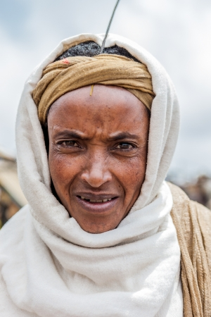 gasena, ethiopia, august 2, 2011:  ethiopian woman posing, gasena weekly market brings together various ethnic groups in the north to exchange or sell their products.