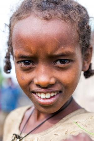 ethiopia: Woreta, Ethiopia, August 6, 2011: Child of Amara ethnic group in the weekly market in the city.