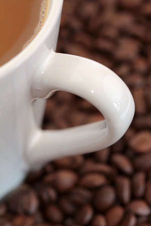Milk coffee with coffee beans
