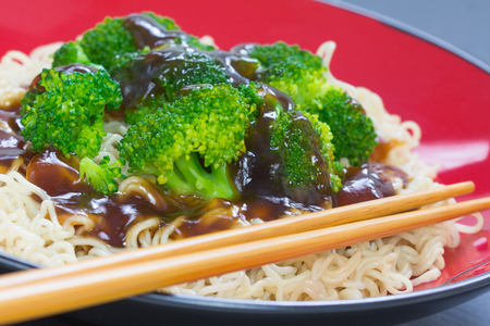 Broccoli with noodles and oyster sauce and sticks