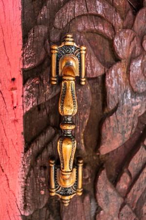 Handle on the old wooden door photo