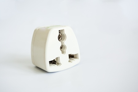 Three different electrical adapters isolated on a white background photo