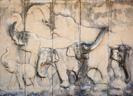 Stone carved elephant on the temple wall  Architecture, which is a popular tourist destination in Thailand  photo