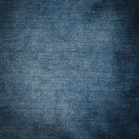 mezclilla: La textura de los pantalones vaqueros azules de cerca Foto de archivo
