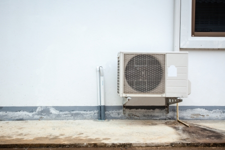 Air conditioner on the wall of boards  photo