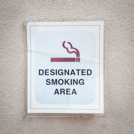 Tag for designated smoking area on wall photo