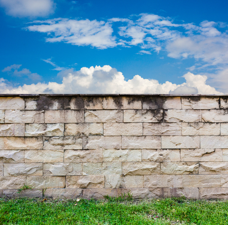 brick wall background and blue sky Stock Photo - 22975578