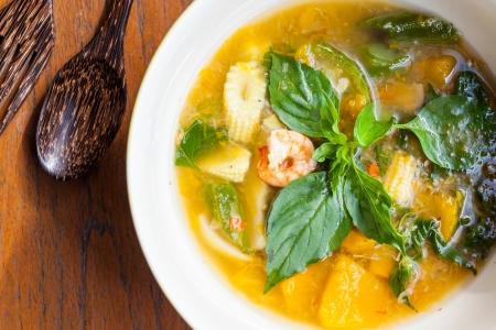 Thai food, Kang liang, Shrimp mushhroom and vegetable on table photo