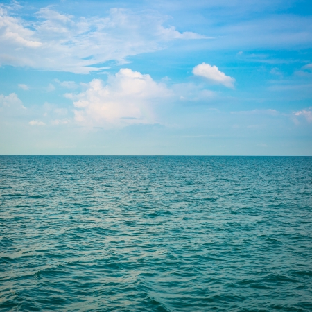 Green sea with waves and clear blue sky photo