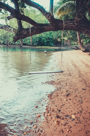 A swing vintage style on the beach at koh chang, Thailand  photo
