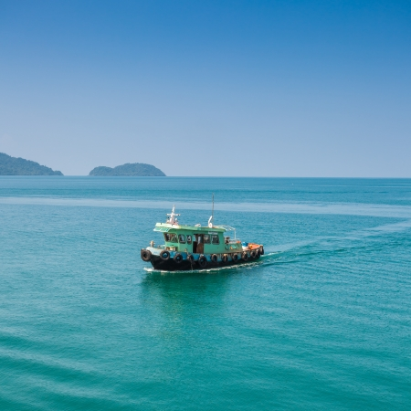Fishing boat on ocean  in koh chang ,thailand photo