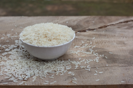 Rice with white cup on wooden table  photo
