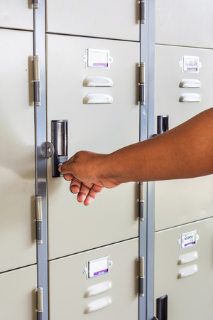 Hand open locker Stock Photo - 24087923