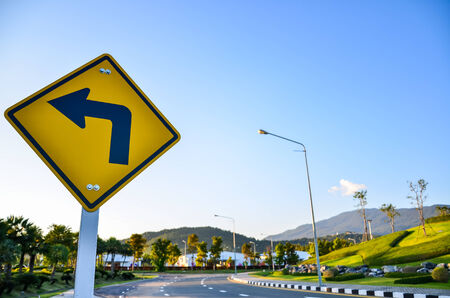 Turn left traffic sign on road Standard-Bild