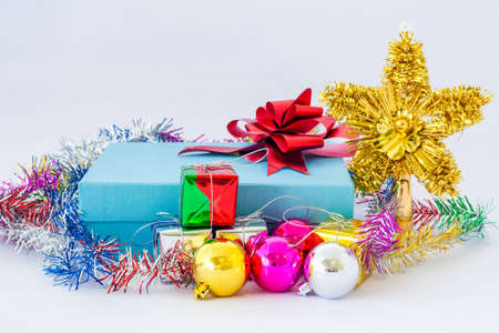 blue gift box with red ribbon on isolated white background photo