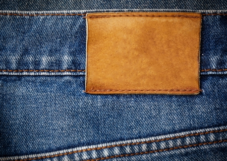 old jeans texture with leather label background close up photo