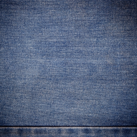 old blue jeans background and texture close up photo
