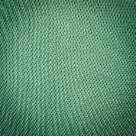 green fabric texture and background close up photo