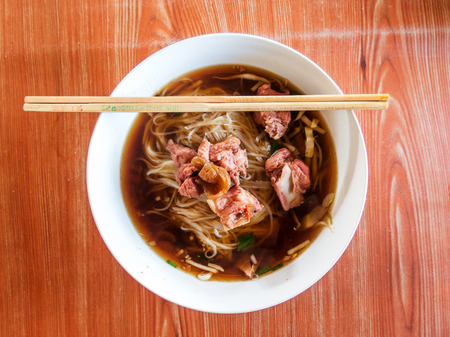 Thai Noodle Soup with Meat on wood table photo