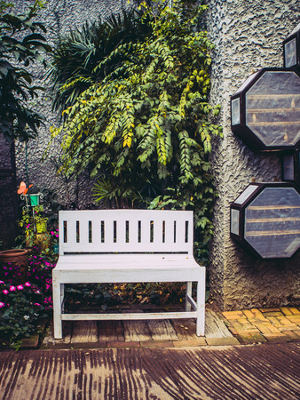white chair in the garden for vintage style  photo