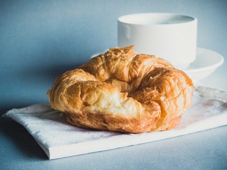 breakfast with croissants, cup of black coffee photo