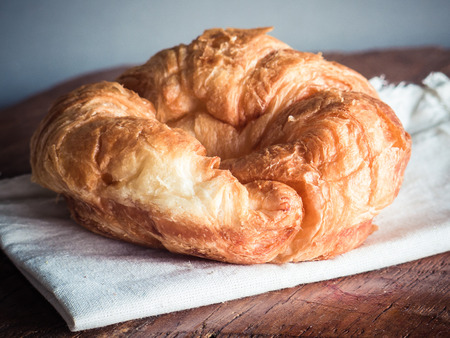 fresh croissants on wood gray background photo