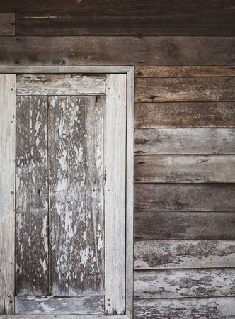 old window of wooden house photo