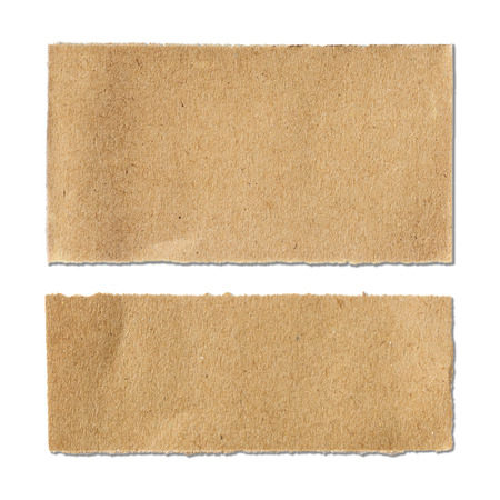 Torn brown paper sheet on white background Фото со стока