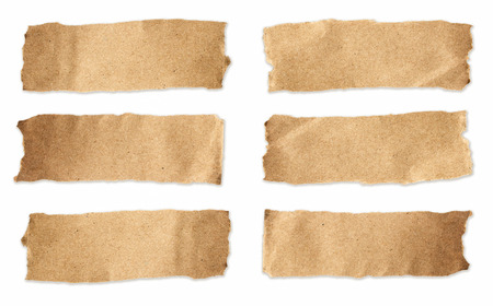 Torn brown paper sheet set on isolated white background photo