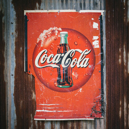 CHIANG MAI,THAILAN D -AUG 23: Old rust condition vintage of Coca Cola logo. on August 23, 2014 in Chiang Mai Thailand.