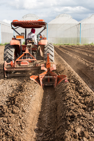 tractor preparation soil working in field agriculture. photo