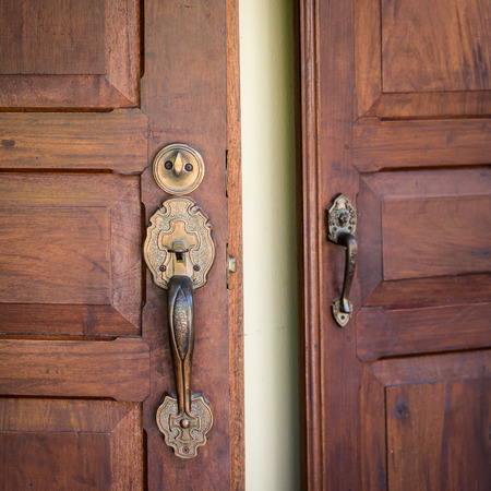 front door: Door Handles and Wooden Close-up