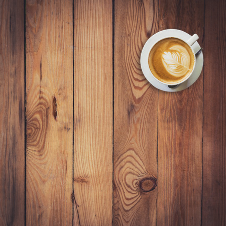 Latte coffee on wood with space photo
