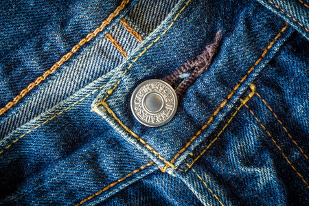 levi: CHIANG MAI, THAILAND- FEBRUARY 15, 2015: Close up detail of button of the LEVIS denim jeans. LEVIS is a brand name of Levi Strauss and Co, founded in 1853.