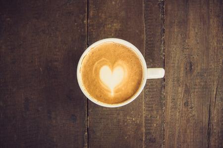 Latte art coffee on wood table