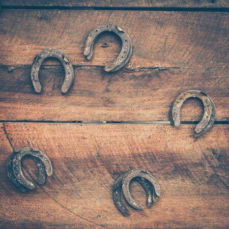 old horse shoe on wood background