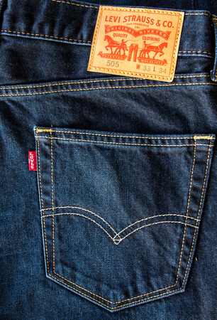 levis: CHIANG MAI, THAILAND- FEBRUARY 15, 2015 - Closeup of leather like heavy card stock label of a pair of Levis brand of denim jeans. Levi Strauss & Co. is a worldwide clothing corporation.