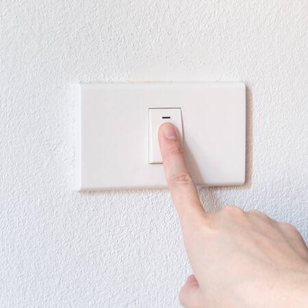 hand woman push button switch photo