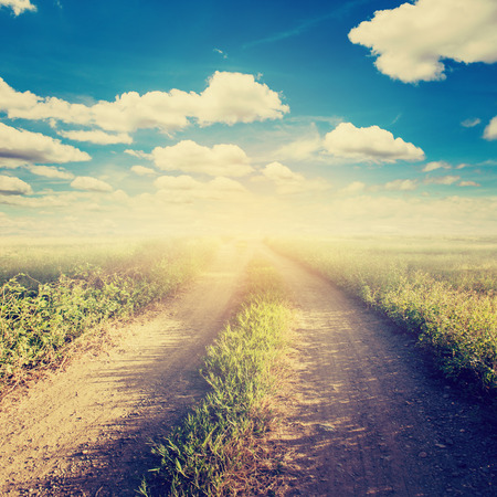 blue grunge background: road and field vintage with sunlight Stock Photo