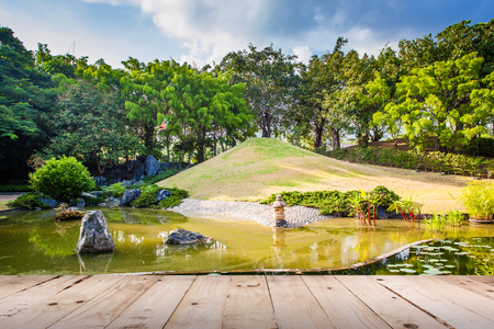 meditaion: Wood floor on Pond and Water Landscape in Japanese Garden Stock Photo