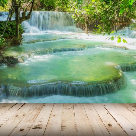 tat: Wood floor and Waterfall in rain forest (Tat Kuang Si Waterfalls at Luang prabang, Laos.) Stock Photo