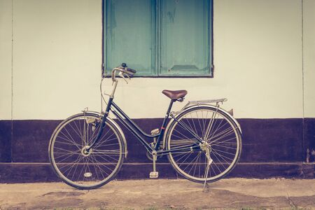 old bicycle: vintage bicycle and background building