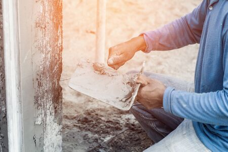 plasterer concrete worker at wall of home construction building Фото со стока - 47652167